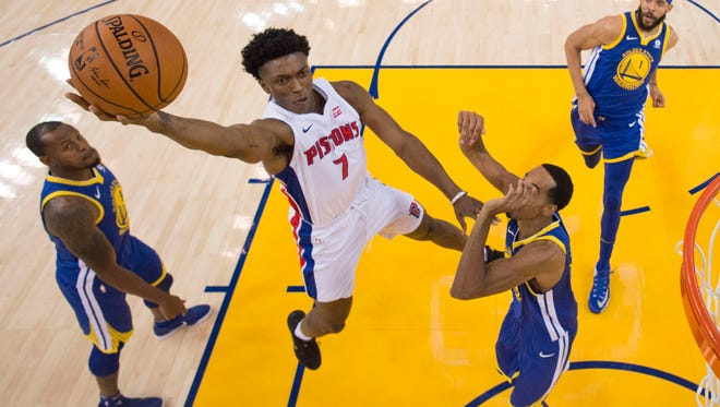 Pistons forward Stanley Johnson (7) shoots the basketball against Warriors forward Andre Iguodala (9), guard Shaun Livingston (34), and center JaVale McGee (1) during the second half of the Pistons' 115-107 win on Sunday, Oct. 29, 2017, in Oakland, Calif.