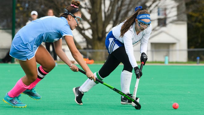 Colchester's Sam Messier, right, and South Burlington's Emma Liebegott battle for the ball during the Division I high school field hockey semifinals in October.
