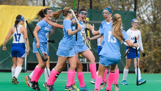 South Burlington celebrates a goal during the girls semi final field hockey game between the Colchester Lakers and the South Burlington Wolves at Moulton Winder field at UVM on Tuesday afternoon October 31, 2017 in Burlington.