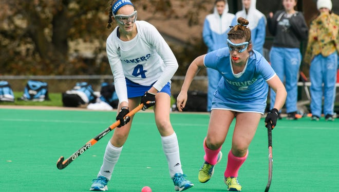 Colchester's Abby Palaza (4) hits the ball past South Burlington's Kate Hall (2) during last year's Division I high school field hockey semifinals.