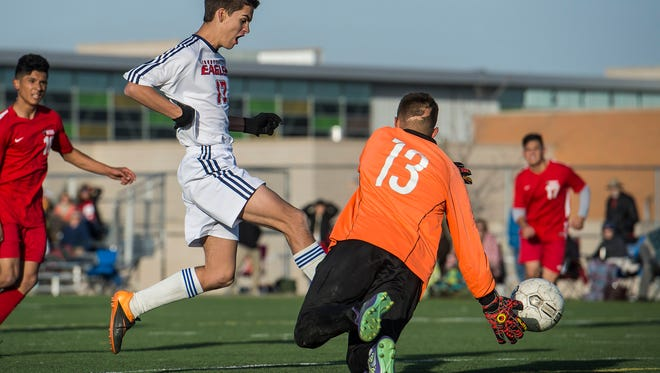 Liberty Commons junior Michael Hoffinger (17) gets a shot past freshman William Smith goaltender Gerardo Lucero Castro (13) for the first goal of a quarterfinals playoff game played Tuesday, Oct. 31, 2017 at Kinard Middle School in Fort Collins, Colo.