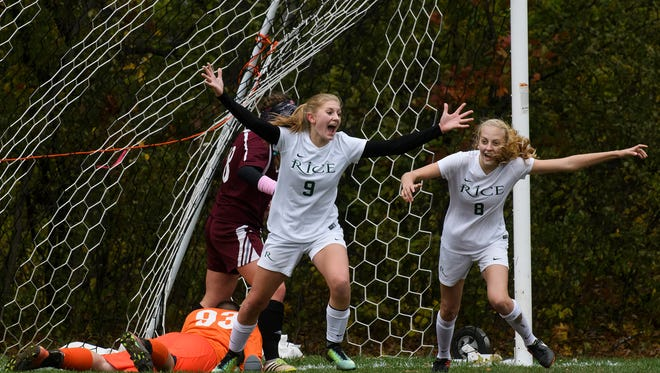 Rice's Alex Dostie (9) celebrates scoring a goal with Ella Gazo (8) during the girls semi final soccer game between the Mt. Abraham Eagles and the Rice Green Knights at Rice High School on Wednesday afternoon November 1, 2017 in Burlington.