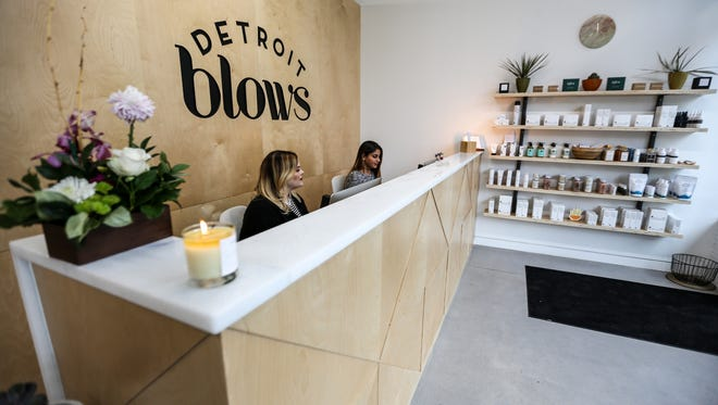 Makeup artist Katie Burton, left, at the front desk with receptionist Sabrina Shariff, 23, of Livonia at downtown Detroit's newest blow-dry bar, Detroit Blows, on Wed., Oct. 25, 2017.