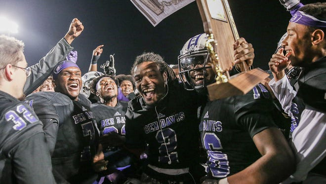 The Ben Davis Giants celebrate the team's 36-29 sectional title win after defeating the Warren Central Warriors at Ben Davis High School, Indianapolis, Friday, Nov. 3, 2017.