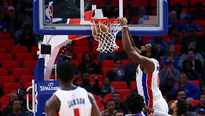 Andre Drummond dunks against the Kings in the first half at Little Caesars Arena on Saturday.