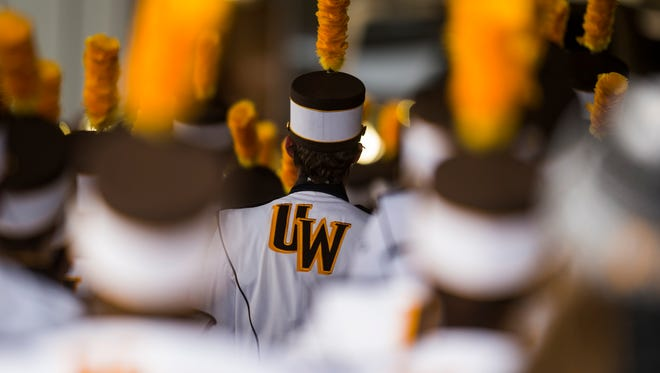 The University of Wyoming band enters the stadium Saturday, Nov. 4, 2017, before a game between CSU and University of Wyoming  at War Memorial Stadium in Laramie, Wyo.