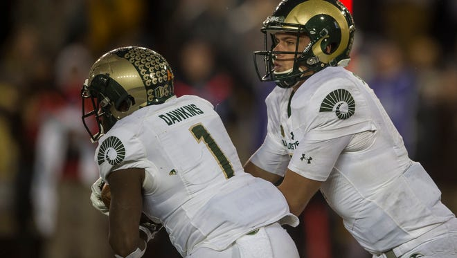 CSU quarterback Nick Stevens (7) hands the ball off the running back Dalyn Dawkins (1) in a game earlier this season. The Rams play Marshall at 2:30 p.m. Saturday in the New Mexico Bowl.