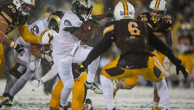 CSU running back Daylyn Dawkins (1) finds a little running room against the Wyoming defense on Saturday, Nov. 4, 2017, during the second half of a game at War Memorial Stadium in Laramie, Wyo.