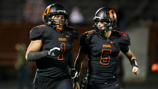 Sprague's Spencer Plant (5) congratulates Noah Mellen (1) on a touchdown against Southridge in a first round OSAA 6A state playoff game on Friday, Nov. 3, 2017, at Sprague High School. Sprague defeated Southridge 57-14.