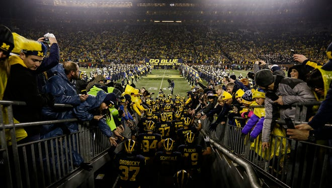Michigan players take the field before a game against Minnesota at the Michigan Stadium in Ann Arbor, Saturday, November 4, 2017.