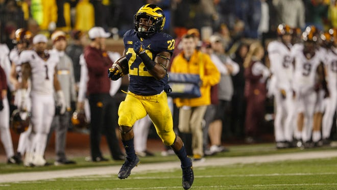 Michigan running back Karan Higdon (22) runs towards the end zone during the first half of a game against Minnesota at the Michigan Stadium in Ann Arbor, Saturday, November 4, 2017.