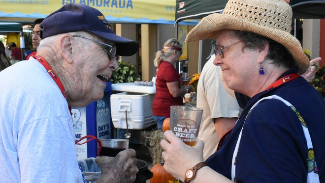World War II vet Bob Sargeant and his daughter Marsha Jarvis enjoy some beer during the third annual Marco Island Craft Beer Festival on Sunday, Nov. 5, 2017 at The Esplanade. The Marco Island Area Chamber of Commerce sponsored the event, which featured more than 20 different brews from six Florida breweries.