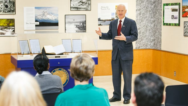 Secretary of State Dennis Richardson talks about the history if the State of Oregon as a restored Oregon Constitution is unveiled at the State Archives on Monday, Nov. 6, 2017.