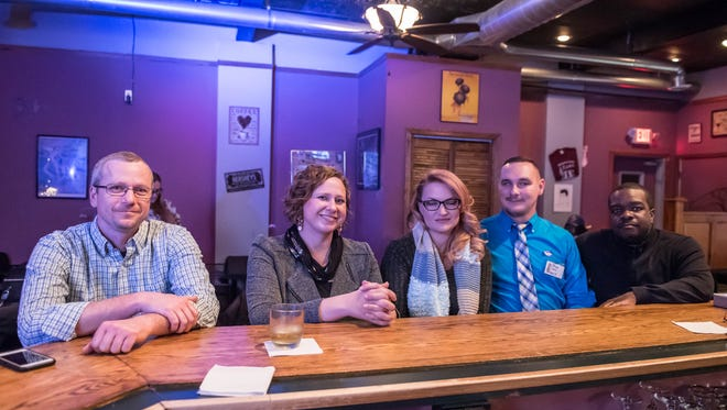 City commission candidates waited for results at 303 West Networking Cafe on Tuesday night. Waiting are candidates Dan Boyd, Kaytee Faris, Adriane MacCreery, Shane Farlin and Lester Johnson. Faris won re-election for her at-large seat.