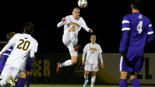 Vermont's Daði Bærings Halldórsson (15) leap to kick the ball during the America East Conference semi final men's soccer game between the Albany Great Danes and the Vermont Catamounts at Virtue Field on Wednesday night November 8, 2017 in Burlington.