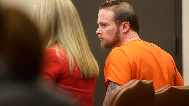 Adam Fulford takes his seat after entering the courtroom before his sentencing on Wednesday, Nov. 9, 2017, at the Larimer County Justice Center in Fort Collins, Colo.