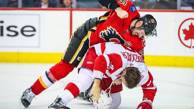 Flames' Troy Brouwer punches Red Wings' Justin Abdelkader in the second period Thursday.