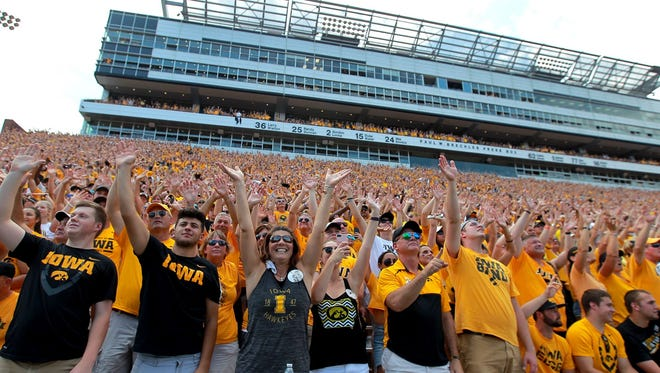 Iowa fans wave to children at the University of Iowa Children's Hospital during the Hawkeyes? game against North Texas at Kinnick Stadium on Sept. 16.