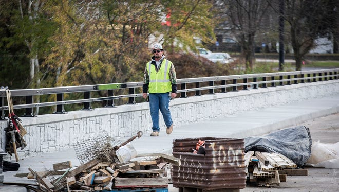 Construction continues on the Tillotson Avenue bridge Friday afternoon.