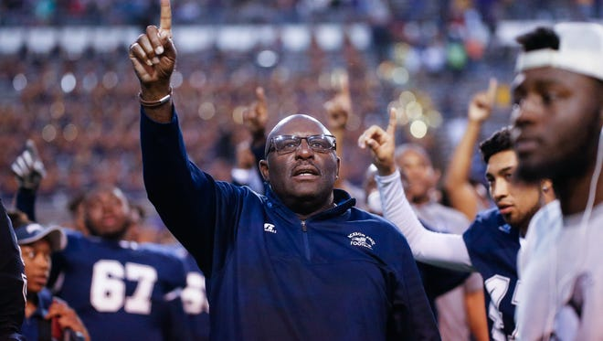 The Jackson State holds up the 'number one' as the band plays the school's alma mater Saturday following the Tigers' 7-3 win over Alcorn State.
