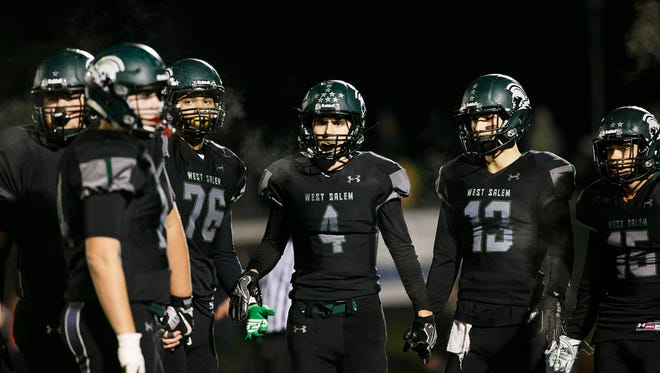 West Salem players huddle up in an OSAA 6A quarterfinal game against South Medford on Friday, Nov. 17, 2017, at West Salem High School. South Medford won the game 28-14.