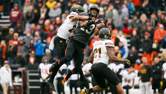 Oregon State's Jordan Villamin (13) tries to catch a pass under pressure from Arizona State's Chase Lucas (24) and Terrell Chatman (21) on Saturday, Nov. 18, 2017, at Reser Stadium in Corvallis, Ore.  Arizona State won the game 40-24.