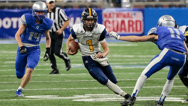 Ottawa Lake Whiteford quarterback Thomas Eitniear (1) runs against Saginaw Nouvel during the first half of the MHSAA Division 8 championship game at the Ford Field in Detroit, Friday, Nov. 24, 2017.