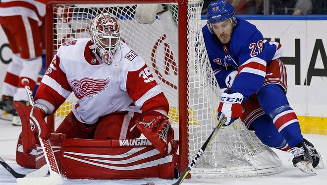 Red Wings goalie Jimmy Howard (35) makes a save on a shot by Rangers center Paul Carey (28) during the second period on Friday, Nov. 24, 2017 in New York.