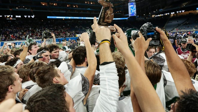 Grand Rapids West Catholic players celebrate after West Catholic's 34-7 win in the Division 5 state title game on Saturday, Nov. 25, 2017, at Ford Field.