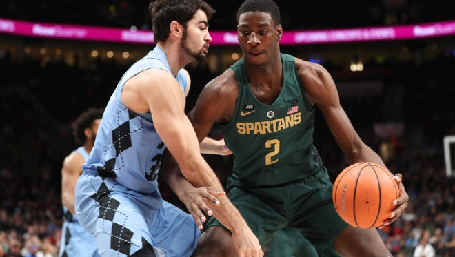 Michigan State forward Jaren Jackson Jr. (2) drives against North Carolina forward Luke Maye (32) in the first half in the Phil Knight Invitational tournament in Portland, Ore., Sunday, Nov. 26, 2017.