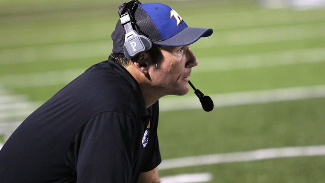 Mukwonago coach Clay Iverson watches the action on the field against Arrowhead in 2015. Iverson resigned from his head post after six seasons on the job.