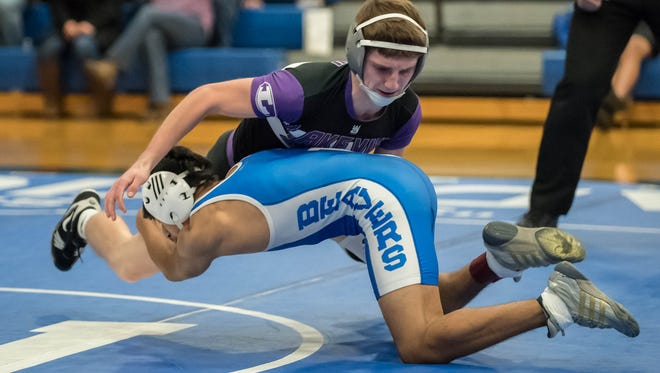 Lakeview's Terry Vette wrestles Harper Creek's Brian Castellanos in the 125 lbs. weight class during All City Wrestling on Wednesday.