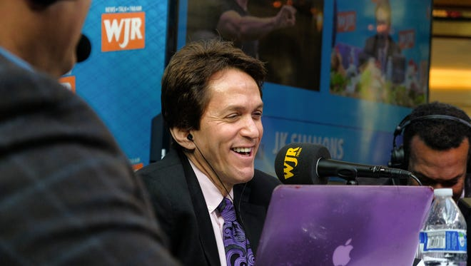 Mitch Albom talks on air during the S.A.Y. Detroit Radiothon benefitting area charities on Thursday, December 7th in the North Grand Court of the Somerset Collection in Troy.