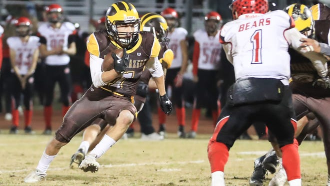 Golden West's Gonzalo Rodriguez (7) cuts inside of Big Bear's defender Jesus Chuy Castro (C)  (1) during a 2017 CIF State Regional Football Championship Bowl Game at Visalia Community Stadium on Dec 8, 2017.