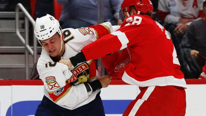 Panthers center Micheal Haley (18) and Red Wings right wing Luke Witkowski (28) fight in the first period on Monday, Dec. 11, 2017, at Little Caesars Arena.