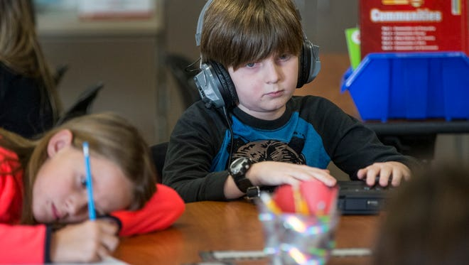 Matthias Vescelus, 9, uses a BrailleNote machine to respond to teacher Kayla Schnaus' questions during class at Promise Road Elementary, Noblesville, Ind., Thursday, Dec. 7, 2017. Matthias is a high-ability third grade student at Promise Road who is also navigating blindness. Since Matthias does not have a one-on-one aide, Schnaus has made sure classwork is always accessible for Matthias, building a close bond along the way.