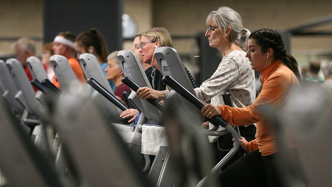 Members work out at the fitness center at the Monon Community Center in Carmel, Ind., seen Wednesday, Dec. 13, 2017.