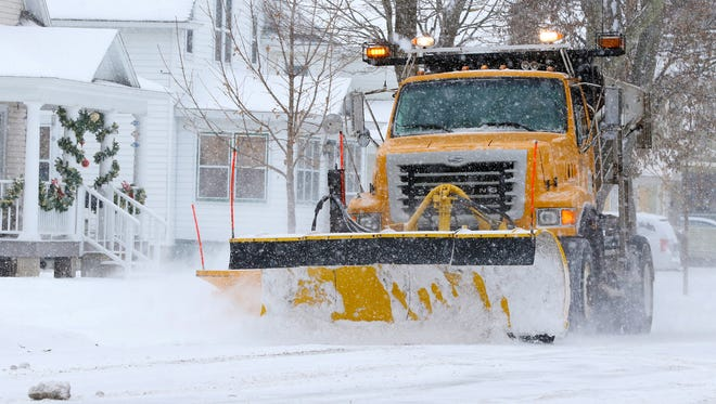 A Wausau city plow clears streets Wednesday afternoon in Wausau. Street crews across central Wisconsin are finding ways to keep roads safer and hurt the environment less.
