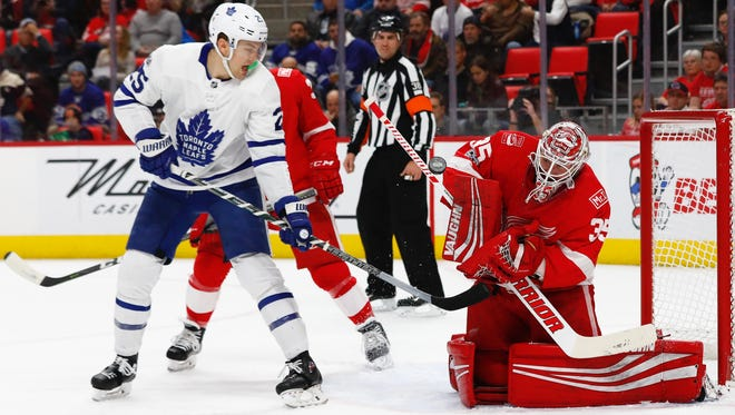 Red Wings goalie Jimmy Howard (35) makes a save against Maple Leafs left wing James van Riemsdyk (25) in the first period on Friday, Dec. 15, 2017, at Little Caesars Arena.