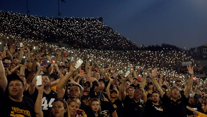 Iowa fans wave to patients at the University of Iowa Children's Hospital during the Hawkeyes' game against No. 4 Penn State at Kinnick Stadium on Saturday, Sept. 23, 2017.