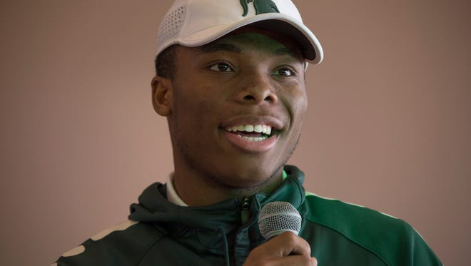 Detroit Cass Tech's Kalon Gervin, who is signing with Michigan State, participates during the signing day event on Wednesday, Dec. 20, 2017, at the Horatio Williams Foundation in Detroit.