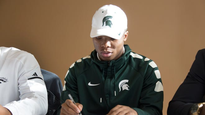 Detroit Cass Tech's Kalon Gervin signs with Michigan State on Wednesday at the Horatio Williams Foundation in Detroit.