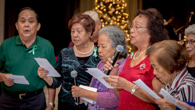 """Music and dancing entertains World War II survivors and their families during an event organized by  The Manenggon Memorial Foundation called """"Christmases Not Forgotten"""" to revive the Christmas celebration they have lost during World War II, held at Leo Palace Resort on Dec. 19.Virgilio Valencia /For Pacific Daily News"""