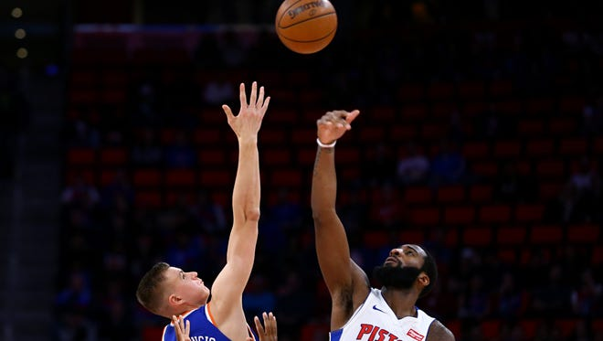 Knicks forward Kristaps Porzingis (6) battles against Pistons center Andre Drummond (0) for the opening tipoff in the first half on Friday, Dec. 22, 2017, at Little Caesars Arena.