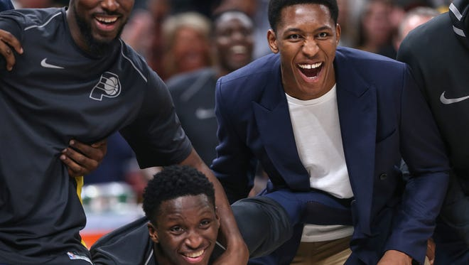 From left, Indiana Pacers forward Alex Poythress (0), Indiana Pacers guard Victor Oladipo (4) and Indiana Pacers center Ike Anigbogu (13) get fired up from the bench during fourth quarter action between the Indiana Pacers and Brooklyn Nets at Banker's Life Fieldhouse, Indianapolis, Saturday, Dec. 23, 2017. The Pacers won in overtime, 123-119.