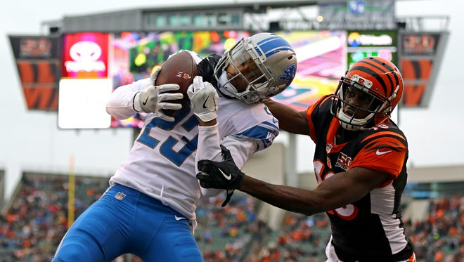 Lions cornerback Darius Slay (23) attempts an interception against Bengals wide receiver A.J. Green (18) but goes out of bounds in the first half on Sunday, Dec. 24, 2017, in Cincinnati.