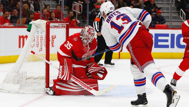 Detroit Red Wings goalie Jimmy Howard (35) makes the save on New York Rangers center Kevin Hayes (13) in the first period at Little Caesars Arena.
