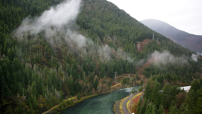 Water flows along the North Santiam Canyon after passing through the Detroit Dam on January 12, 2018, in Detroit, Ore.