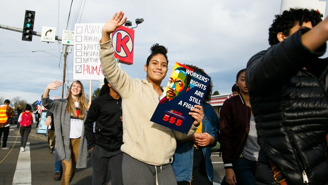 West Salem High School student Sydney McCarrell marches at a Martin Luther King Jr. Day march on Monday, January 15, 2018. About 300 people showed up the event, which began with a rally at McKay High School followed by a march along Lancaster Drive.
