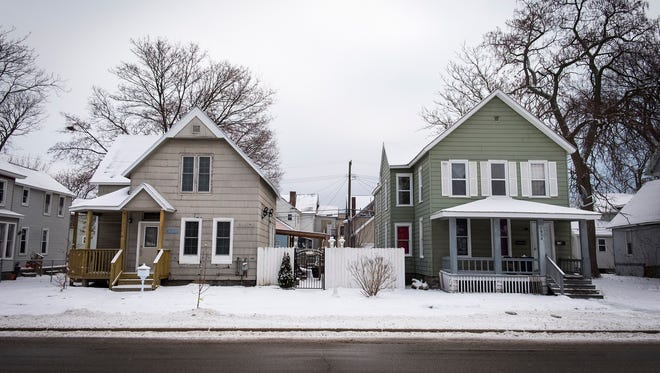 Snow covers the rooftops on houses along Sixth Street in Port Huron. More snow is expected tonight and Sunday.